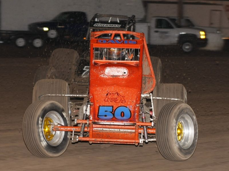 Charles Davis, Jr. (50) in front of Jeremy Sherman (77) in Saturday night's Discount Tire Co. ASCS Canyon Region event at Manzanita Speedway in Phoenix, AZ.