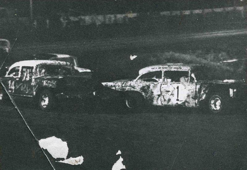 Wolfman leads unknown driver out of turn four, Lubbock ca. 1969-71.